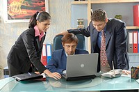 South Asian Indian businessmen and woman working on laptop conversation to each other in his office MR 670D , 670F ,670G