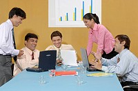 South Asian Indian businessmen and woman sitting in conference room and conversation to each other MR 670D , 670E , 670F ,670G , 670H