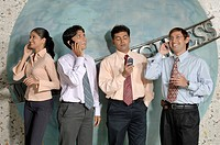 South Asian Indian businessmen and woman standing and talking on mobile in office MR 670E , 670F ,670G , 670H
