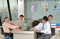 South Asian Indian businessmen and woman working and talking on phone in office MR 670E , 670F ,670G , 670H