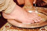 Var pooja welcoming groom by washing feet in Indian Maharashtrian Hindu wedding