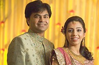 Wedded Bengali bride and bridegroom in Indian Hindu wedding reception ceremony MR716V,716W