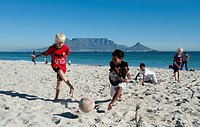 Children playing football on the beach in Bloubergstrand, Table Mountain at back, Cape Town, Western Cape, South Africa, Africa
