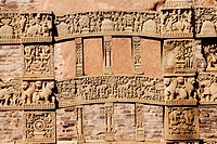 Gateway or torna of maha stupa no 1 with depiction of stories engrave decorations erected at Sanchi , Bhopal , Madhya Pradesh , India