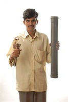 Indian man profession Plumber with tools and pipe MR 693Y