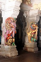 Richly carved and Colourfully painted fighting of mythological animals on pillar of Ramanathswami temple , Tamil Nadu , India