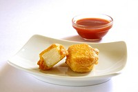 Indian cuisine , fast food starters Cheese Pakode puffs served with tomato ketchup in dish on white background