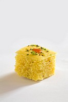 Indian cuisine , fast food Dhokla with tomato ketchup in dish on white background