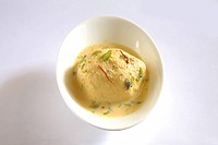 Indian sweet , kesar rasmalai garnish with pistachio and saffron served in bowl