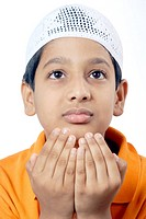 Muslim boy wearing topi praying namaz MR152