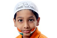 Muslim boy painted Indian flag tattoos on both cheek celebrating Independence day MR152