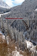 Arosa train on the Langwies Viaduct in a beautiful mountain landscape near Arosa in Grison, Switzerland