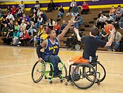 Warren, Michigan - The Sterling Heights Challengers, a team of disabled high school students, plays wheelchair basketball against non-disabled faculty...