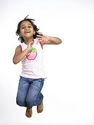 South Asian Indian girl jumping with joy in nursery school MR