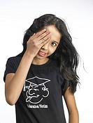 South Asian Indian young girl keep hand on one eye MR