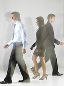 South Asian Indian executive men and woman walking MR