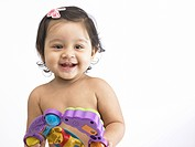 Indian baby girl holding toy MR702O