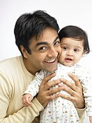 Portrait of Indian father and baby girl MR702O,702A