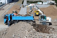 Backhoe and dump truck at a construction site, Koblenz, Rhineland-Palatinate, Germany, Europe