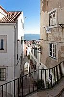 One of the narrow streets of Alfama with the typical cobblestone staircases Beco da Corvinha  Alfama, Lisbon, Portugal