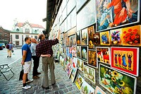 Painter showing his paints at the city centre of Krakow, Poland