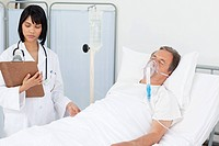 Nurse whith her mature patient in a hospital