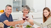Family drinking wine together at home