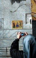Nun taking a photo inside The Haghia Sofia Mosque, Istanbul, Turkey