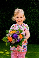 Child with flowers. Gift for Mother