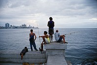 Havana, Cuba  Men fishing on the Malecon