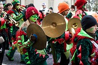 Guggenmusig Noggirugger group dressed to the theme of dragons during the carnival procession in Malters, Lucerne, Switzerland, Europe