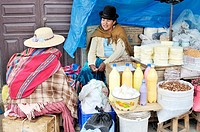 Street sale of fresh cheese and other farm products from the Penas Valley, Oruro, Bolivia, South America