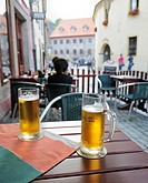 Cool Budweiser beer in the historic old town, Cesky Krumlov, Czech Republic, Europe