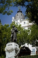 Sculpture by Francisco Goya, Spanish painter, Ritz Hotel on the Paseo del Prado at back, Madrid, Spain, Europe