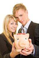 Teenagers with piggy bank