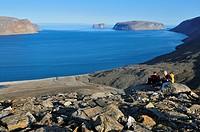 Hiker overlooking Sunnshine Fjord, Baffin Island, Nunavut, Canada, Arctic
