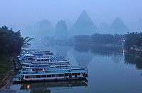 ships on Li River at Yangshuo in Guilin region of China