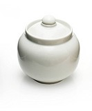 Sugar bowl isolated on white background. Studio lighting.