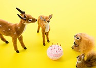 Deer and squirrel figurines and cake
