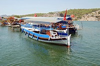 Tourist boats moored on Dalyan riverside, near place where Dalyan river goes to Aegean Sea at Iztuzu Beach Turtle Beach