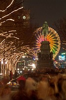Unter den Linden avenue at Christmas time with statue of Friedrich II, illuminated Ferris wheel, Mitte district, Berlin, Germany, Europe