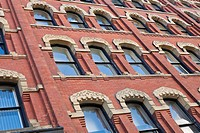 Decorative arches over windows in brick building in Saint John, New Brunswick, Canada