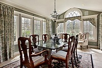 Breakfast area in suburban home with wall of windows