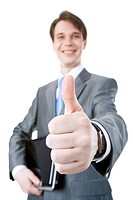 Close_up of businessmans hand showing thumb up on the background of male with laptop