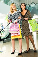 Photo of beautiful girls in the mall on the background of escalator