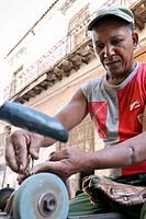 Street worker sharpening a tool, La Habana, Cuba, Caribbean