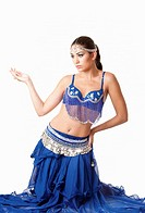 Beautiful Israeli Egyptian Lebanese Middle Eastern fashion belly dancer performer in blue skirt and bra sitting on knees, isolated
