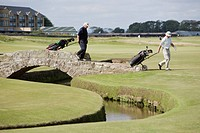 Men playing golf, The Royal and Ancient golf course, St. Andrews, Fife, Scotland