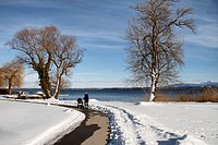 Woman with baby pram, push chair on the Fraueninsel island in winter, Lake Chiemsee, Chiemgau, Upper Bavaria, Germany, Europe