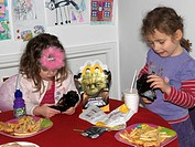 Sisters Having a Mcdonald's Happy Meal Playing With Star Wars Toys England